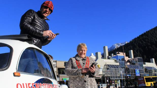 Downtown Queenstown manager Steve Wilde and Queenstown Lakes District mayor Vanessa van Uden connect to free wi-fi.