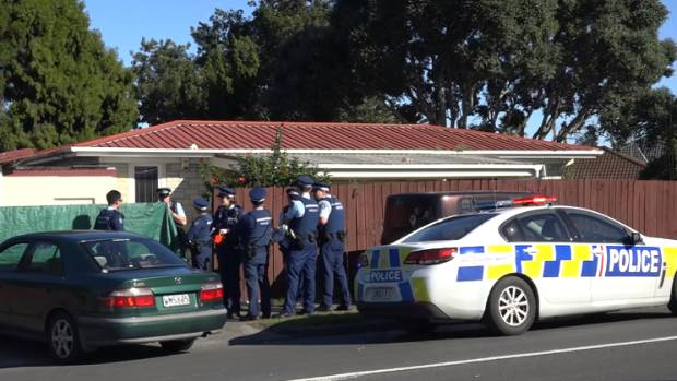 Police investigate outside the Favona Rd home in Mangere where the two-year-old-girl was shot dead.