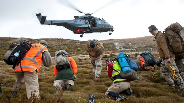 Army and DOC staff on Mt Fell waiting for the NH90 helicopter.