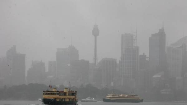 Sydney Ferries on Sydney Harbour heading to Circular Quay in heavy rain conditions.