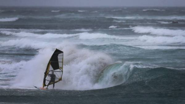 A windsurfer at Nobbys Beach, Newcastle.
