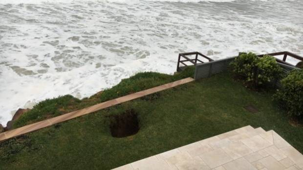 A sinkhole opened up in the lawn in front of Brian Vegh's home in Collaroy, Sydney.