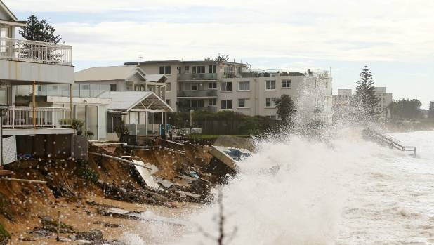 Evacuated houses hit by big waves on Sydney's northern beaches.