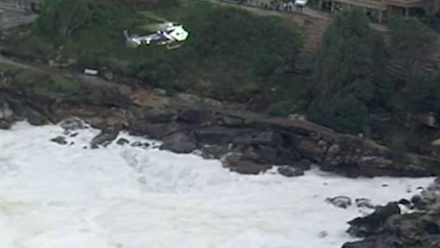 The person was swept off the rocks at Bondi, near the Icebergs, about 3pm (5pm NZT).