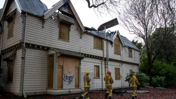 Neighbours say huge flames leapt from a historic Christchurch community centre after it caught fire on Monday night.