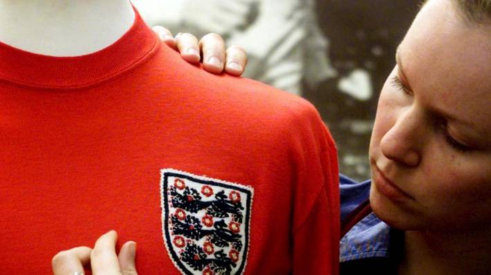 74b208ca51c Geoff Hurst s jersey gets a bit of attention before being auctioned in  London.