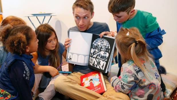 Reading opens up the world for children. Here Samuel Loussouarn of My Little French Bookman reads to children at Red ...