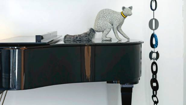 Swarovski crystals are sewn into Louise Weaver's crocheted raccoon, sitting on top of the grand piano in Lynn Whitfield ...