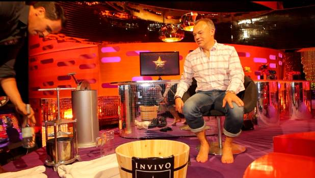 Graham Norton prepares to stomp Invivo grapes, prepared by Invivo co-founder Tim Lightbourne (left), during The Graham ...