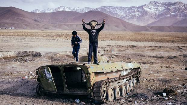 Two boys play on an old Soviet armoured personnel carrier in Murghab, Tajikistan.