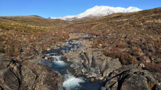 One of the many waterfalls along the track to Tama lakes, with Whakapapa in the background.