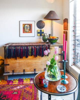 In the lounge of Anne and Peter Stephens' Napier apartment, a large wooden chest from southern India is draped with a ...