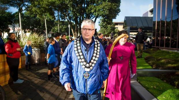 New Plymouth mayor Andrew Judd and  Anglican Archbishop Philip Richardson take the first steps in the peace walk on ...