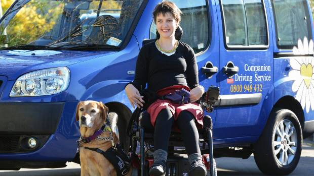 Bridget McLaren's mobility dog Goldie not only changed her life with his companionship and dexterity, he helped her win ...