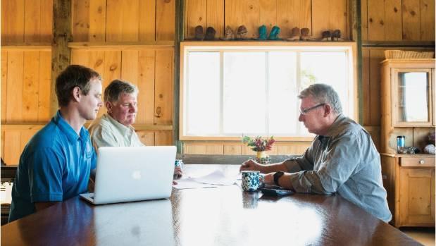The three men examine Xero's new tool for financial planning.