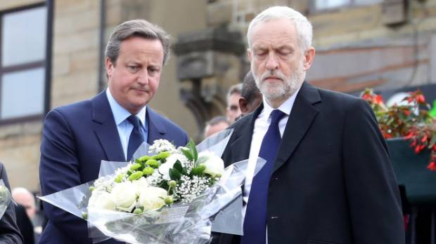 UK Prime Minister David Cameron and Labour Leader Jeremy Corbyn pay their respects near to the scene of the murder of Jo Cox.