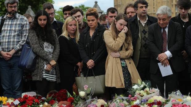 Members of the public including John Bercow, Speaker of the House of Commons, right, gather near tributes during a vigil ...