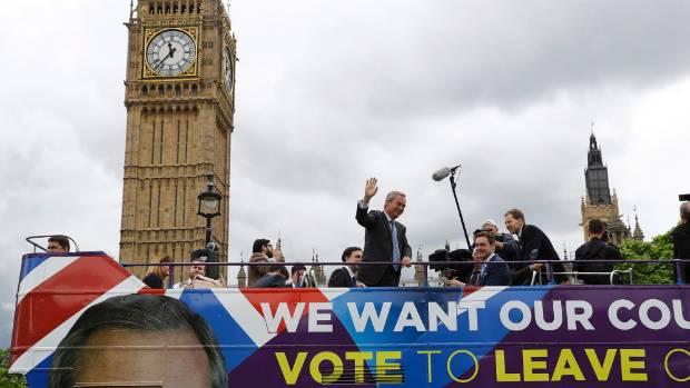 "UKIP leader Nigel Farage aboard a ""Leave"" campaign bus."