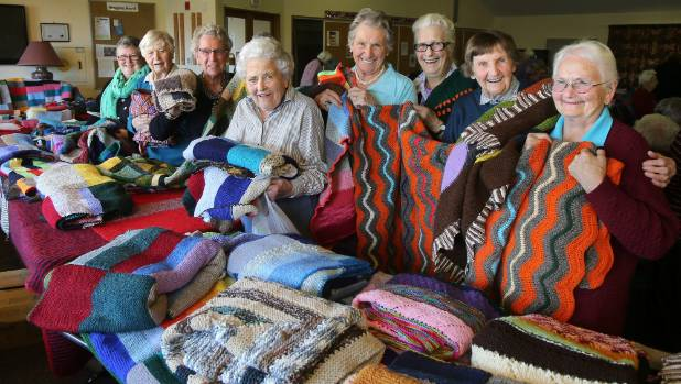 Group Of People Knitting : Knitting group works on shipment of woollen goods for