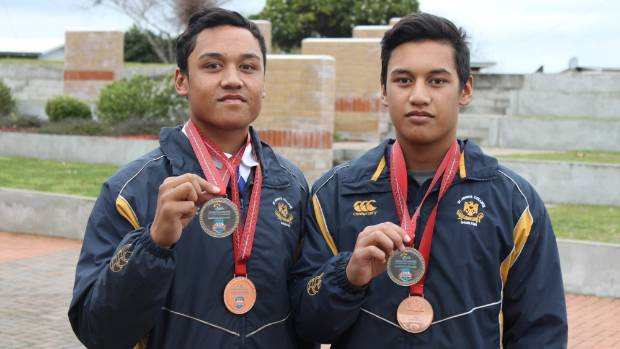 Brothers Ezra (left) and Te Kopere Simmons are bronze and silver medallists at the Waka Ama World champs.