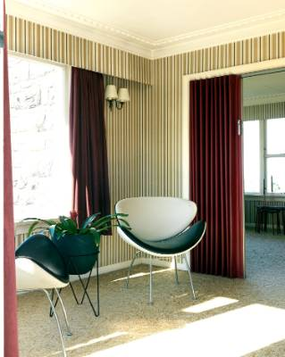 The original fabric sliding doors are burgundy on one side, cream on the other.