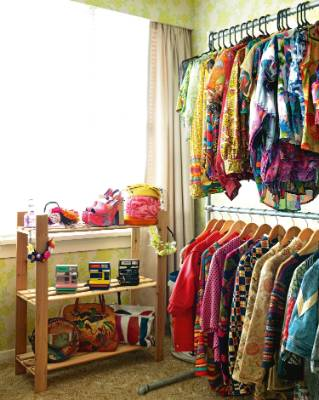 A spare bedroom serves as a walk-in wardrobe for Tannia's collection of vintage clothing, shoes and accessories, which ...
