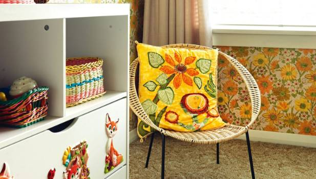 The cushion on the little cane chair in Nova's room was hand-embroidered by Tannia's aunt Adair, another keen op-shopper.