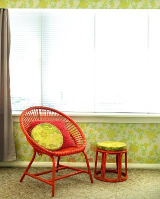 Tannia bought the orange cane chair from Trade Me, then spray-painted the side table to match.