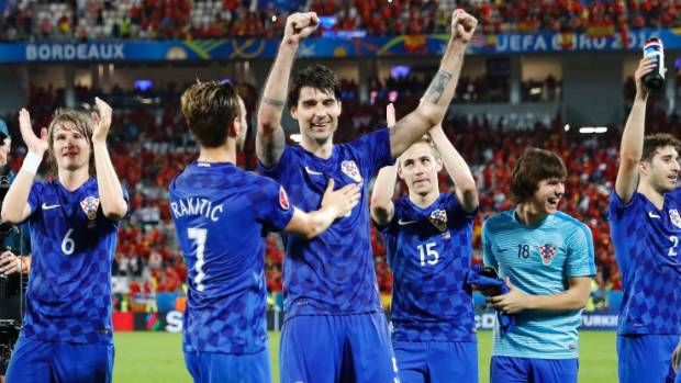 244c7ac32e3 Croatia celebrate at full time after beating Spain 2-1 to top Group D at