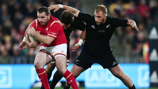 Ken Owens is tackled by Owen Franks of New Zealand during the International Test match in Wellington last year.