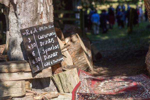A sign welcomes guests to the ceremony.