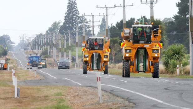 Grape harvesters make their way up the Wairau Valley.