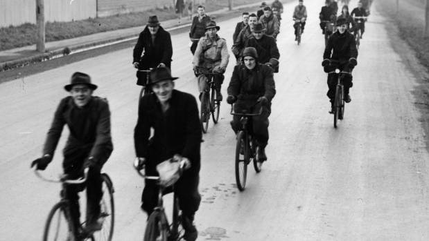 Workmen ride their bicycles from work in Addington in 1946.