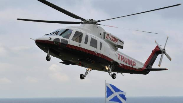 Republican presidential candidate Donald Trump arrives by helicopter at his Turnberry golf course, Scotland.