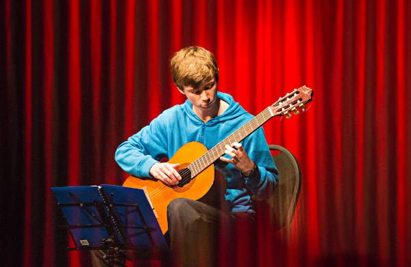 Classical Guitar Society's mid year concert at the Wall Theatre. It's Thomas Williamson's turn to shine.