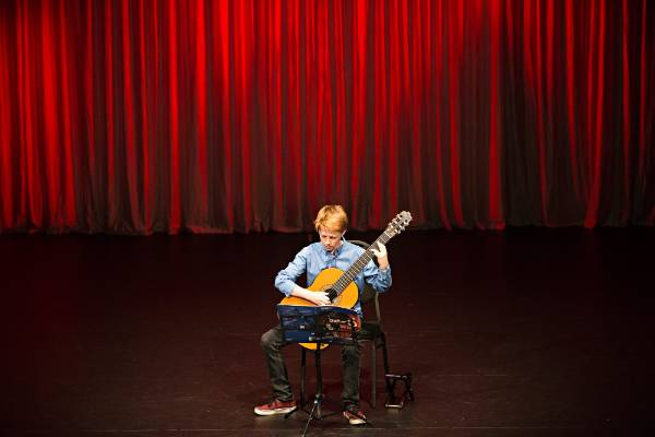 Classical Guitar Society's mid year concert at the Wall Theatre in New Plymouth. Hamish Goodhue plays for the audience.