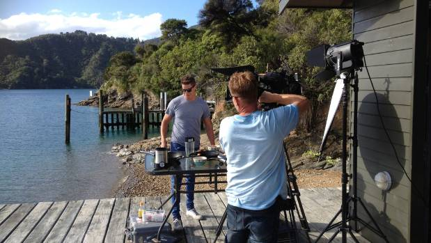 Nick cooks a curry for filming in the Marlborough Sounds for new series Best of New Zealand with Nick Honeyman.