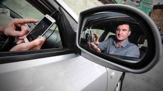 A car and a phone: All you need to be an Uber driver. But are the rewards shared?
