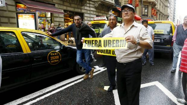 Everywhere the backlash: Taxi drivers in Buenos Aires protesting the arrival of Uber in April.