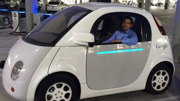 Future perfect: Transport Minister Simon Bridges tries Google's prototype driverless car on trip to California.