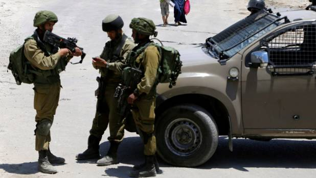 An Israeli military spokesman said the girl was attacked in her bedroom.