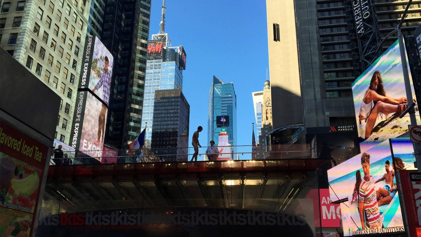 Naked man jumps from ledge of Times Square ticket booth