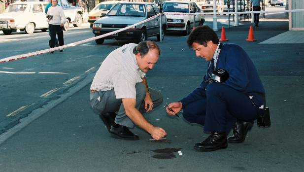 Nelson police tape out areas of blood found at the scene in Hardy St where Kevin O'Loughlin died after being stabbed.