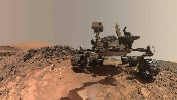 A low-angle self-portrait of NASA's Curiosity Mars rover showing the vehicle at the site from which it reached down to ...
