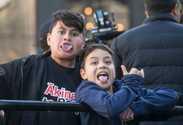 Hunt for the Wilderpeople star Julian Dennison, and Hawaiki Morrison,9, give their best pukana as the parade makes its ...