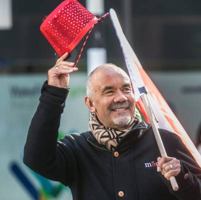 Maori Party co-leaderTe Ururoa Flavell tips his hat to the parade.