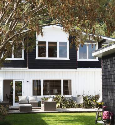 The 1964 Eastbourne house belonging to Nicole van Ruler and Andrew Tokeley used to be brown – they stained it black ...