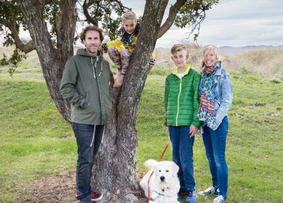 Andrew and Nicole with Daan, 13, Luka, seven, and Jimmy the golden retriever in the seaside park opposite their home.
