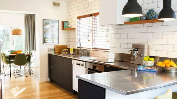 """Everyone goes for white in kitchens, but black works really well with colour, too, and with this being a mid-century ..."