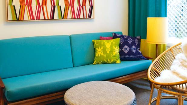 The second living room is decorated with framed fabric by Pierre Frey; the cushions are from Bali.